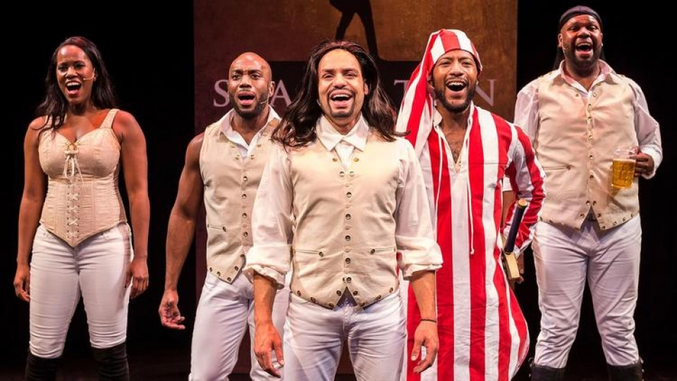 "Zakiya Young, left, Wilkie Ferguson III, William Cooper Howell, John Devereaux and Dedrick A. Bonner in the West Coast premiere of ""Spamilton"" at Center Theatre Group's Kirk Douglas Theatre in Culver City. (Craig Schwartz)"
